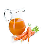 carrot juice in pitcher with carrots