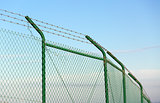 Mesh fence with barbed wire