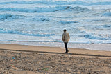 Man Walks Along Coast