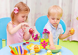 Children paint Easter eggs