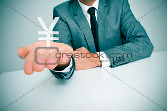 businessman and chinese yuan or japanese yen sign