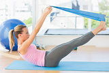 Sporty woman stretching body in fitness studio