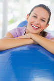 Portrait of a smiling fit woman with exercise ball