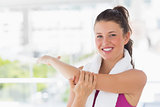 Portrait of a sporty woman stretching hand at yoga class