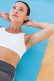 Determined young woman doing abdominal crunches