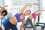Sporty women stretching hands at yoga class