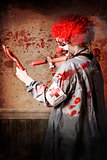 Scary medical clown injecting horror into limb