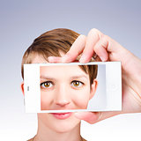 Tech smart woman taking a photo with mobile phone
