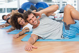 People doing pilate exercises in fitness studio