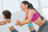 Cheerful fitness class doing pilates exercise