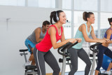 Fit people working out at spinning class