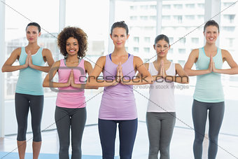 Fit class with hands joined at fitness studio