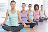 Sporty women in meditation pose with eyes closed