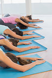 Women in meditation pose at fitness studio