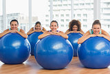 Portrait of smiling people with exercise balls