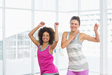 Cheerful fit women doing pilates exercise