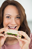 Closeup portrait of a woman eating sandwich