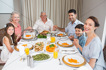 Portrait of an extended family at dining table