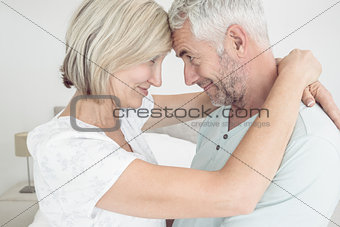 Side view of a loving mature couple