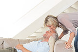 Woman kissing a mans forehead in the living room