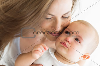 Closeup of a smiling mother and baby