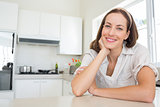 Portrait of a smiling young woman in kitchen