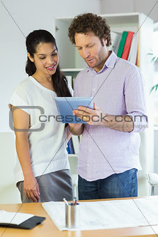 Business people using digital tablet