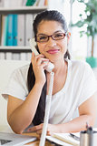 businesswoman using landline phone in office