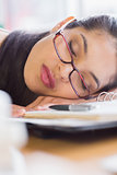 Closeup of businesswoman sleeping on desk