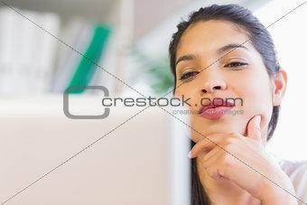 Beautiful businesswoman looking at laptop
