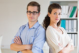Confident businessman and woman in office