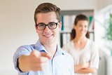 Confident businessman pointing in office