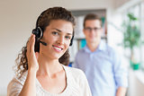 Female customer service representative wearing headset