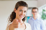 Confident businesswoman pointing in office