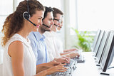 Customer service representatives working at desk