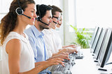 Call center operators working at desk
