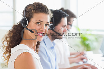 Call center operator wearing headset in office