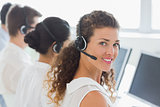 Female customer service agent with colleagues