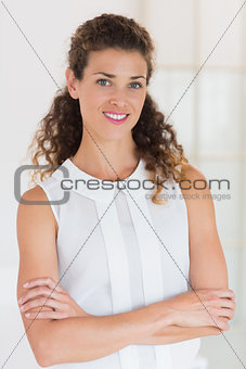Beautiful businesswoman with arms crossed