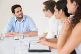 Confident businessman discussing in meeting