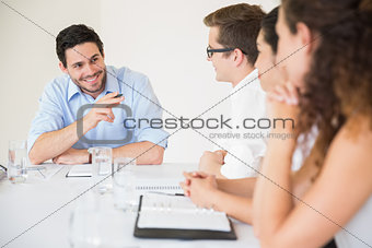 Smiling businessman in meeting