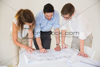 Business people working on blueprint