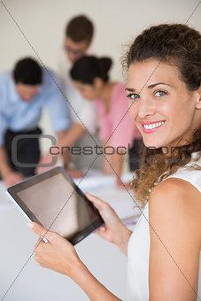 Beautiful businesswoman holding digital tablet