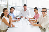 Smiling business people at conference table