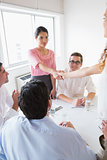 Businesswomen shaking hands during meeting