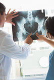 Doctor and nurse analyzing xray