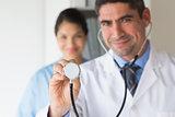Smiling doctor holding stethoscope