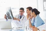 Smiling medical team analyzing xray