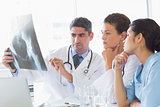 Male doctor discussing xray with colleagues