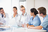Team of doctors and nurses discussing